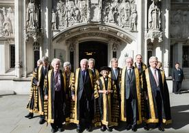 The justices of the UK Supreme Court in front of the Middlesex Guildhall where the Court is located.