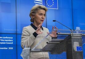 Commission President Ursula von der Leyen speaking at the European Parliament yesterday as Polish Prime Minister Mateusz Morawiecki (on the right) listens.